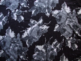 0000B74 tricot zwart - grijs bloem