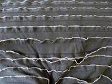 0 a25 NAJAAR 2014 tricot zwart grijs ruches/strookjes