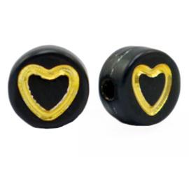 Zwarte kralen met gouden hartjes per 10 st.