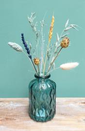 Blauw vaasje met droogbloemen