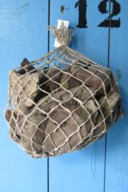 Drijfhout in net