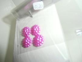 Flatback's met bolletjes in zakje voor 0,20 euro.donker roze