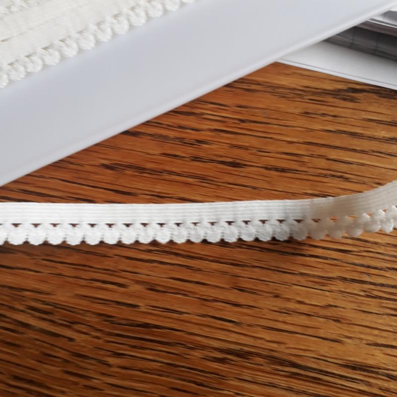 Nylon stretch kant, 12 mm ecru kleur 089