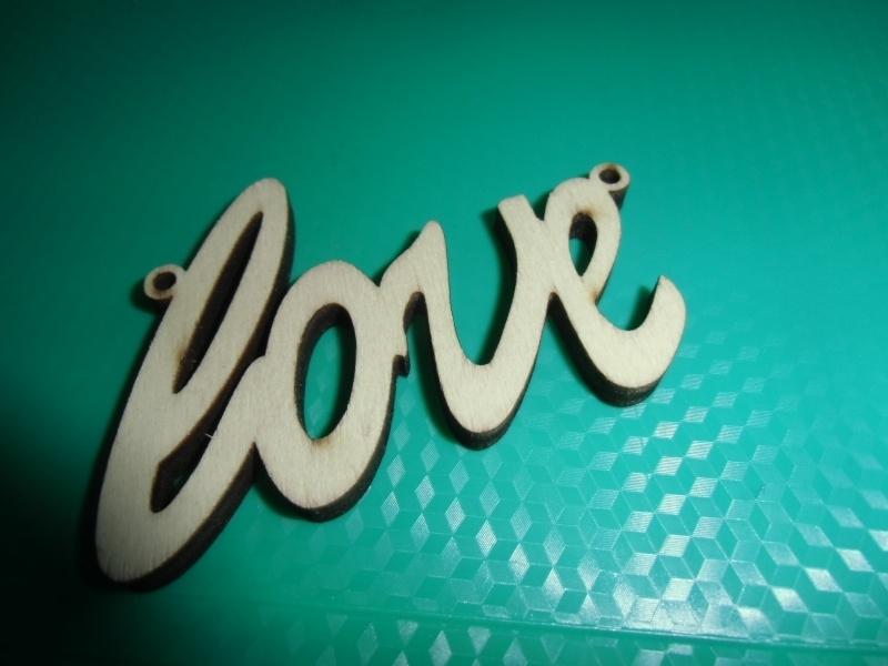 Love, houten tussenzetsel.