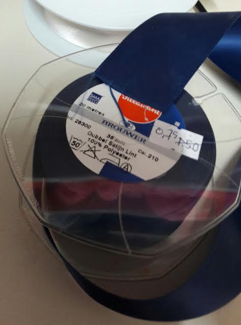 Satijnlint dubbelzijdig  donkerblauw 35mm.  Prijs is per meter