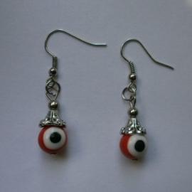 Boze oog oorbellen rood