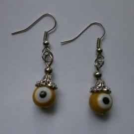 Boze oog oorbellen geel