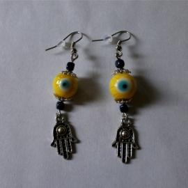 Boze oog oorbellen geel 2