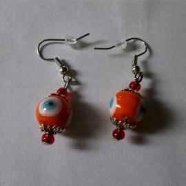 Boze oog oorbellen oranje 2