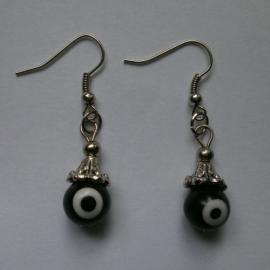 Boze oog oorbellen zwart