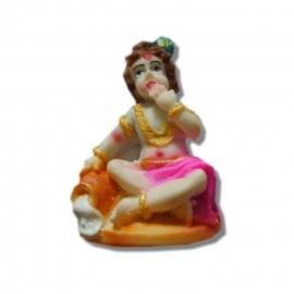 Krishna als kind resin beeld