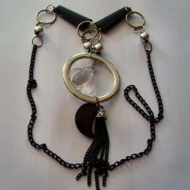 Lange zwarte ketting met zilveren ring