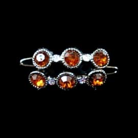 Speldjes amber rondjes met strass