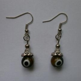 Boze oog oorbellen bruin