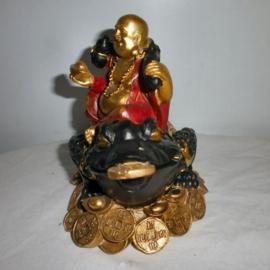 Happy boeddha op welvaartskikker