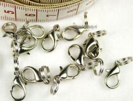 Clasps platinum kleur. 12 stuks.=