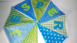 Jesper in lime groen en aqua blauw met gekleurde letters