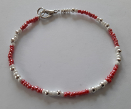armband  rood wit of donkergrijs wit
