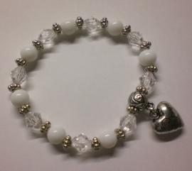 Gratis zelfmaak armband met hart hanger  bij  een  bestelling vanaf €25,00