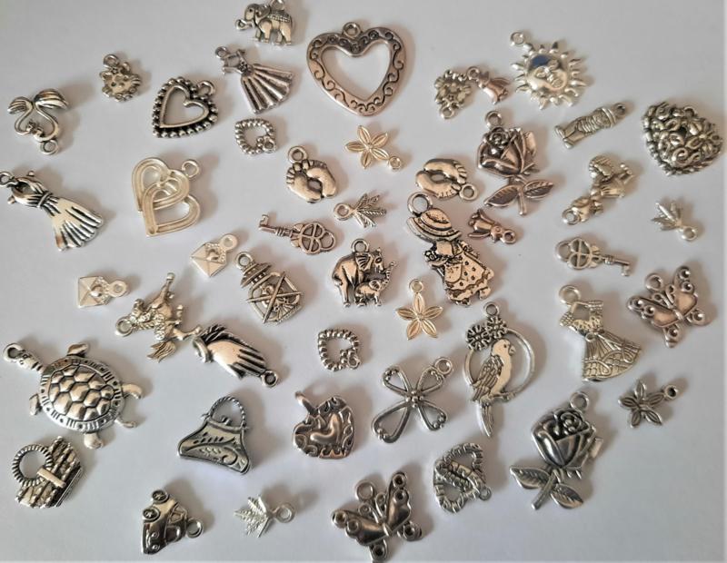 100 xTibetaans zilveren bedels