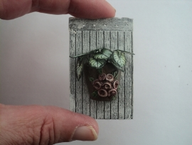 Houten wandbord met plant