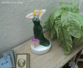 Statue pin-up girl in green dress