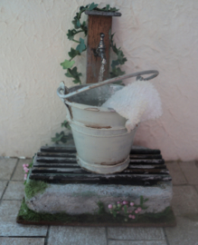 Water tap with bucket