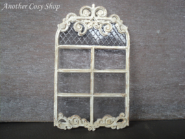 Miniature arch window