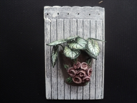 Wall plaque with plant