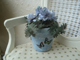 Blooming flowers in blue pot