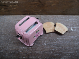 "Dollhouse miniature toaster with two pieces of toast in 1"" scale"
