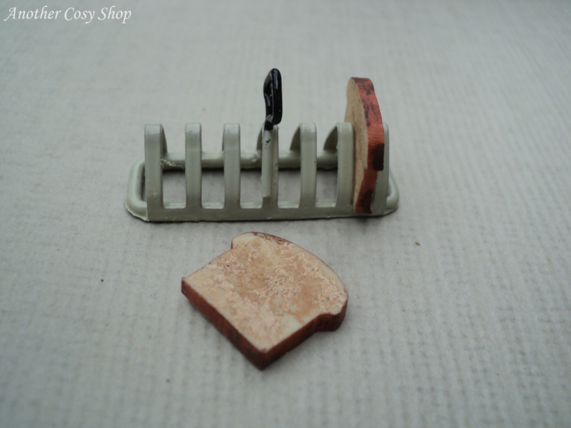 "Dollhouse miniature rack with toast in 1"" scale"