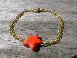 SALE. Armbandje oranje Ster.