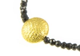 Armbandje Blinckstar rondje, goud/zwart.