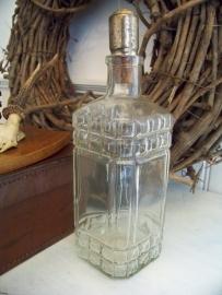 Glazen fles met verzilverde dop