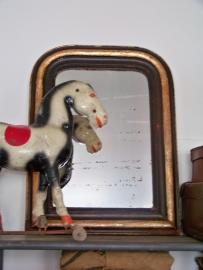 Verweerde franse spiegel