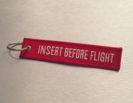 Insert Before Flight Sleutelhanger Rood