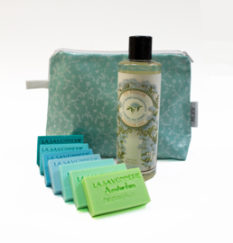 Washbag filled with soaps and showergel