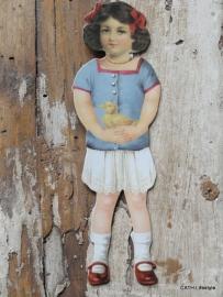 Nostalgishe hanger meisje in het blauw