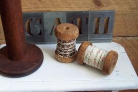 TI Band op hout klosje