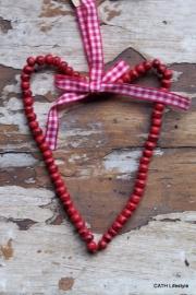 Hartje / Rode kralen