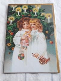 Kerstkaart - meisjes met speelgoed