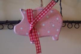 Roze varkentje met strik.