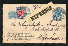 Postblad G 15 met bijfrankering en langebalkstempel AMSTERDAM naar Kopenhagen. EXPRESSE.