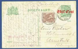 G - Briefkaart met overdruk en bijfrankering van WINSCHOTEN naar Duitsland.