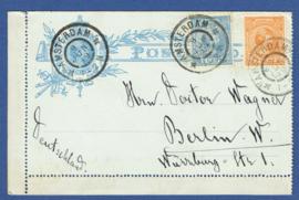 Postblad G 5 met bijfrankering met grootrondstempel AMSTERDAM naar Berlin, Duitsland.