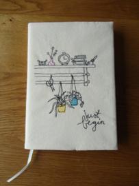 Notitieboekje met boekomslag
