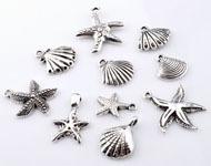 09913 Mix metalen hangers/bedels schelpen en zeesterren ± 16-29mm 10 st