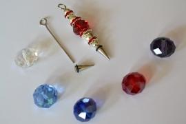 A5 Magic Pin met een puntpin en een rode tussen kraal