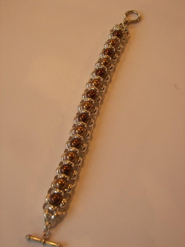 A1652 Armband jasseron met D bruine en goudbruin parels 8 mm